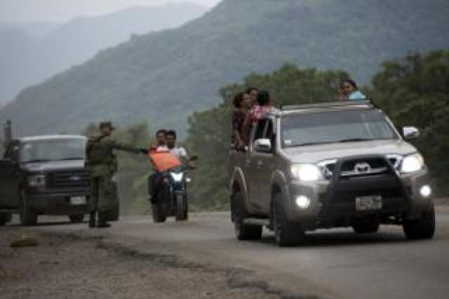 Migrants at a checkpoint by Mexican security forces in southern Mexico