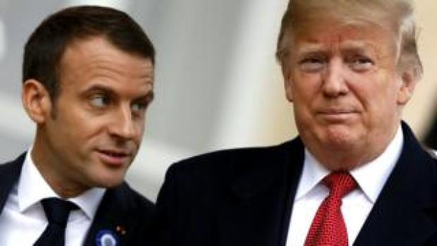 US President Donald Trump (R) is welcomed by French president Emmanuel Macron prior to their meeting at the Elysee Palace in Paris, 10 November 2018