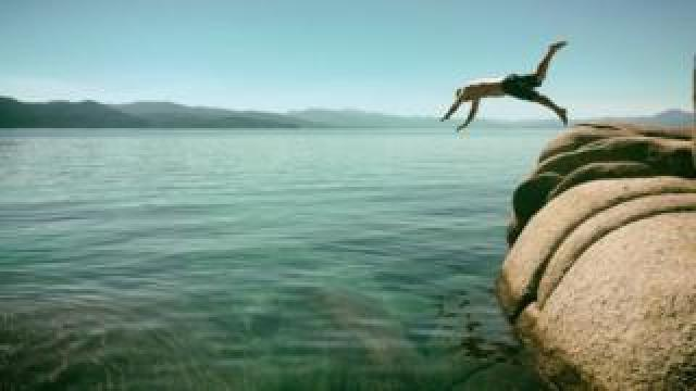 Diving off rocks into shallow water
