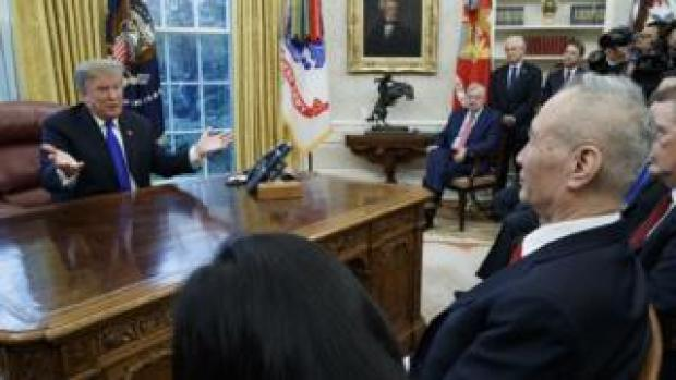 """US President Donald J. Trump (L) talks with Vice Premier of the People""""s Republic of China Liu He (R) during a meeting in the Oval Office of the White House in Washington, DC, USA, 22 January 2019."""