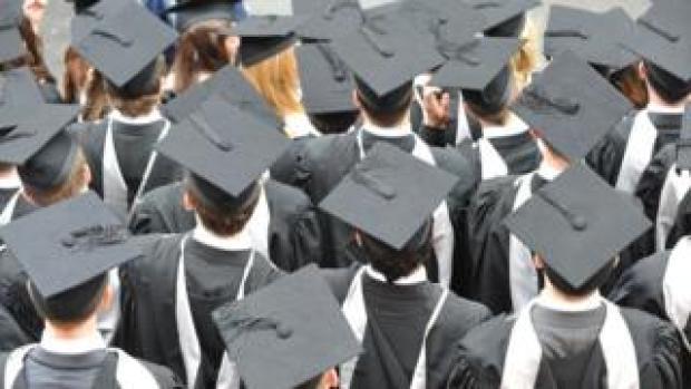 graduates in mortar boards
