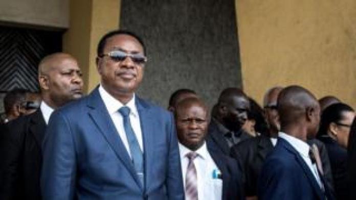 Prime Minister Bruno Tshibala standing with other officials
