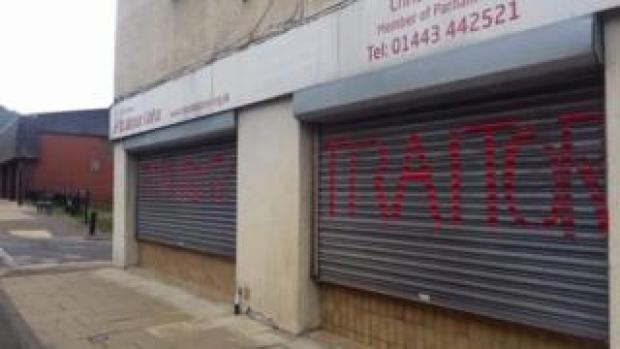 Shutters on Chris Bryant's offices with graffiti reading 'Traitor'