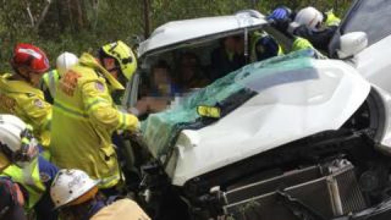 Rescuers work to free the man from the car wreckage