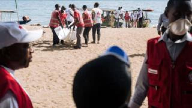 red cross volunteers helping at the shore