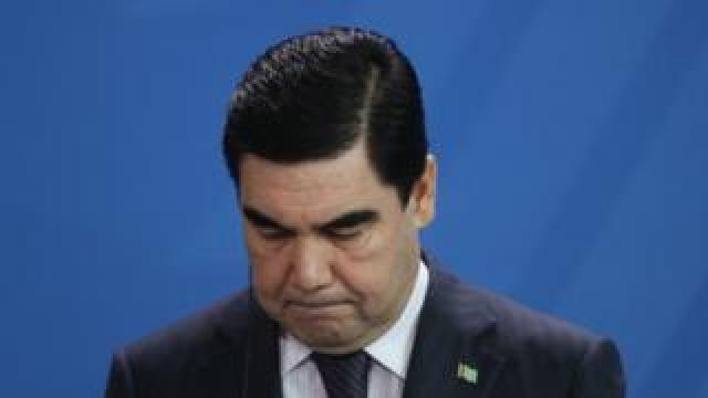 Gurbanguly Berdymukhamedov looking downward