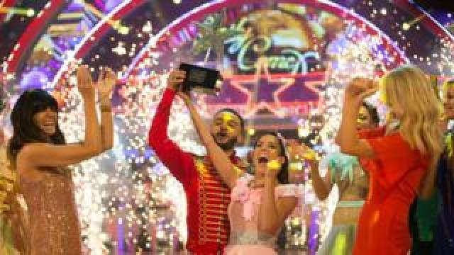 Aston Merrygold and Janette Manrara lift the trophy