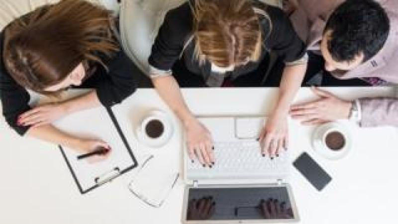 Young employees at a desk
