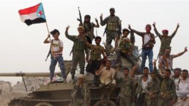 Members of the UAE-backed southern Yemeni separatist forces stand atop a tank during clashes with government forces in Aden on 10 August