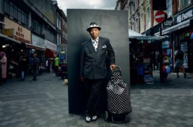 Portrait of a man in the street wearing a stripey suit