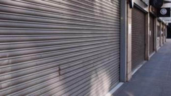 Jewelers are shuttered on a deserted Hatton Garden in London's Clerkenwell district.