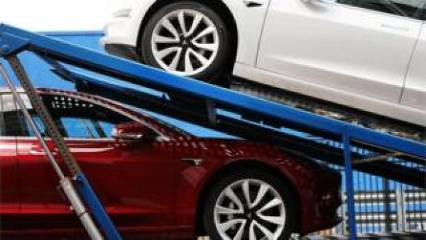 Tesla cars on a delivery lorry