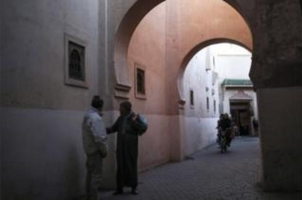 Men talking in an alleyway in the Old Medina of Marrakech, Morocco, Tuesday, March 28, 2017