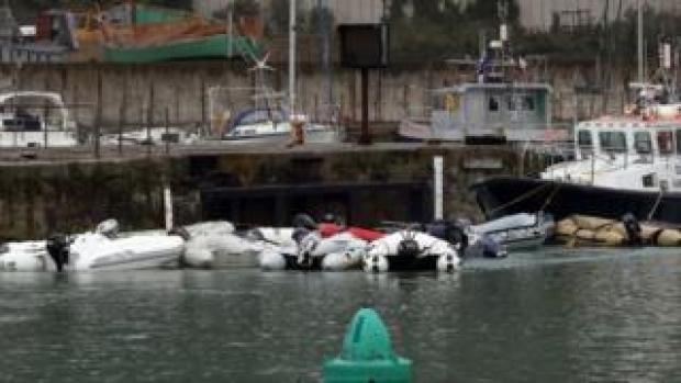 Small boats in storage after being used to bring migrants across to Dover