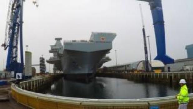 HMS Prince of Wales leaving Rosyth dock