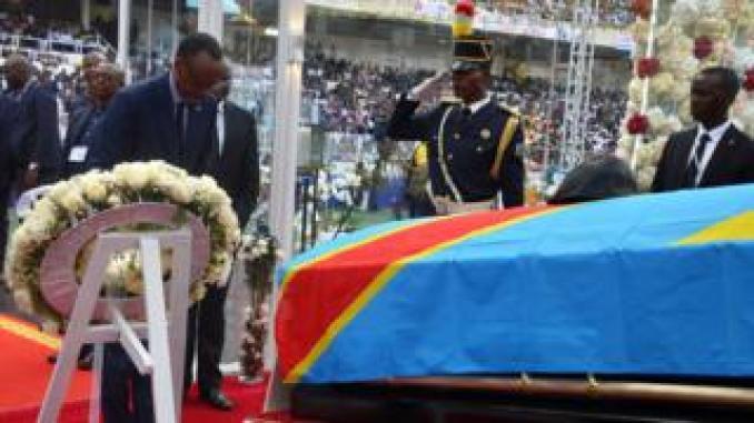 Rwanda's President Paul Kagame pays his respects