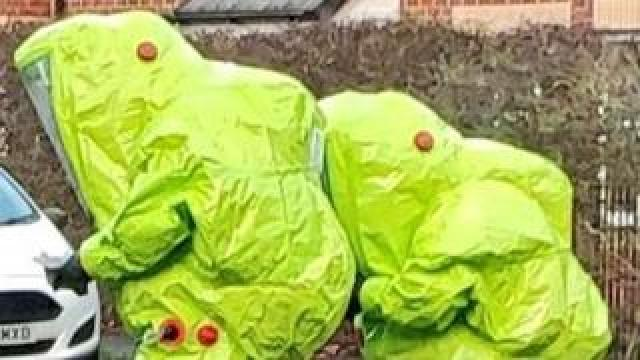 officers in hazardous materials suits