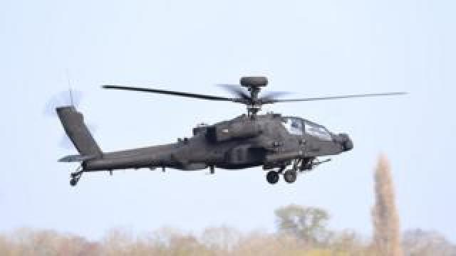 An Apache helicopter taking off from Wattisham Airfield in Suffolk
