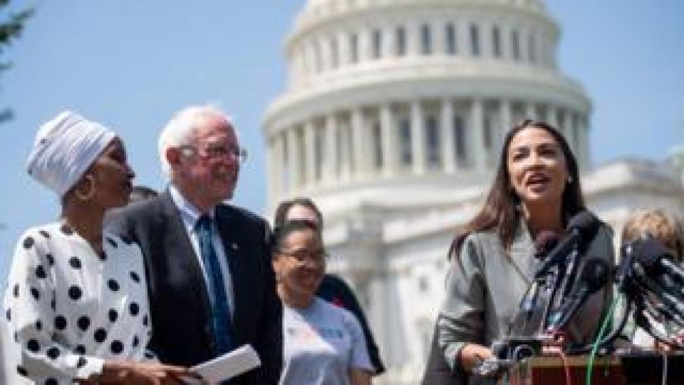 trump Representative Alexandria Ocasio-Cortez speaks alongside US Senator Bernie Sanders and Representative Ilhan Omar outside US capitol