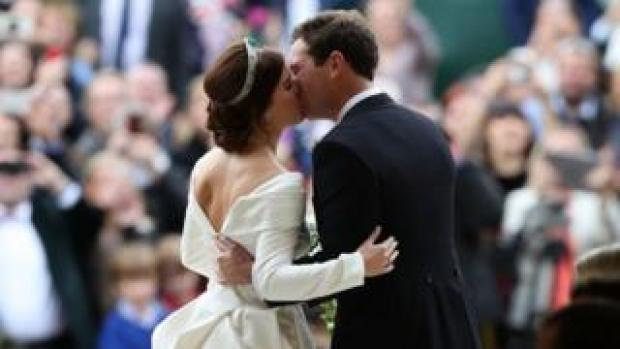 """Princess Eugenie and her new husband Jack Brooksbank kiss as they leave St George""""s Chapel in Windsor Castle following their wedding"""