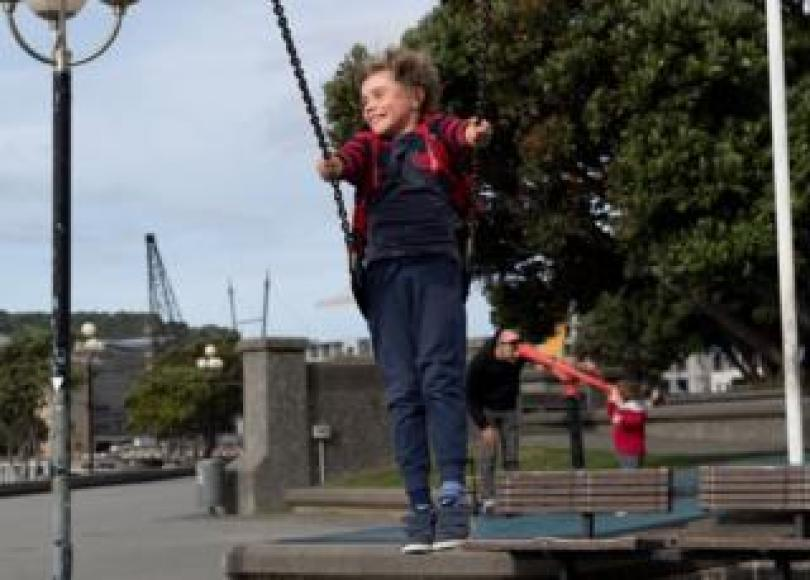 A child plays on a swing at a park in Wellington on 14 May, 2020.