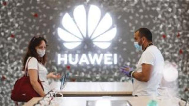 People buy at a Huawei store in Barcelona, Spain