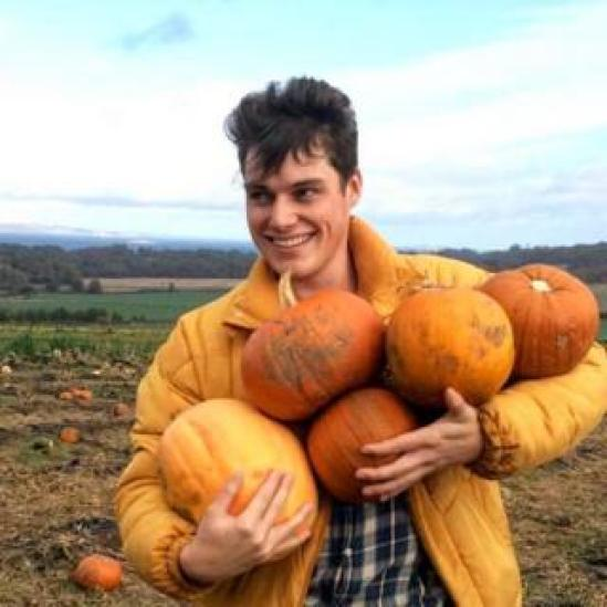 Scott Ridout with the pumpkins he gathered