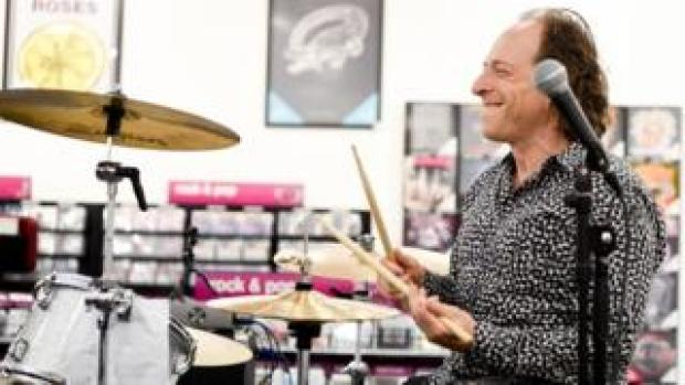 Julian Richer playing the drums