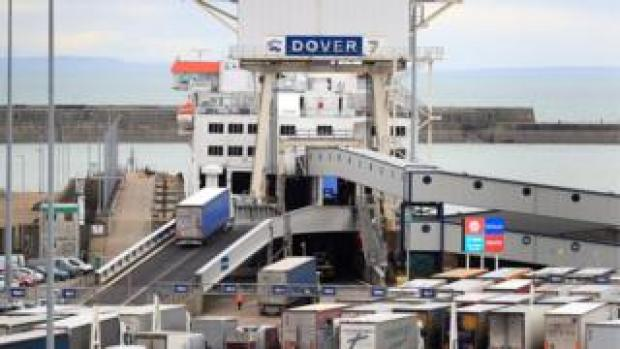 A lorry boards a cross channel ferry at the Port of Dover in Kent