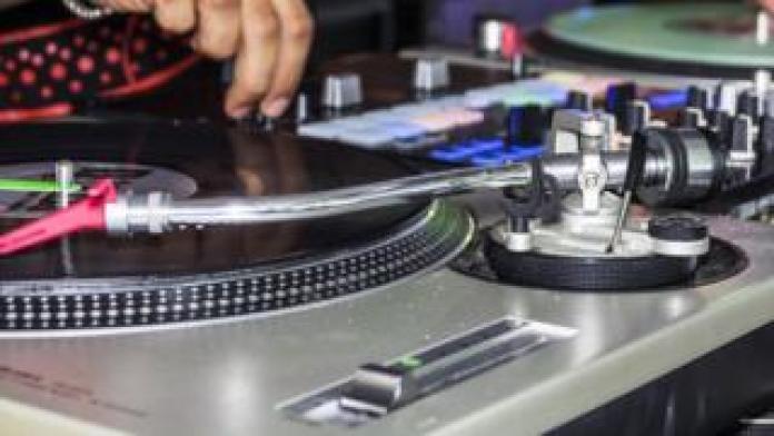 A closeup of a DJ at work