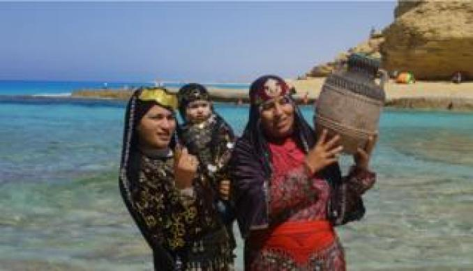 A family wear traditional clothing and pose for a photo on the beach at Marsa Matruh in Egypt on 8 June.