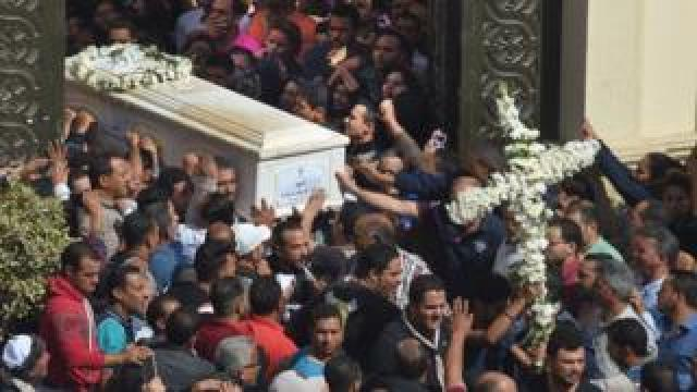 "Coptic Christians carry the coffins of victims killed in an attack a day earlier, following a morning ceremony at the Prince Tadros church in Egypt""s southern Minya province, on November 3, 2018"