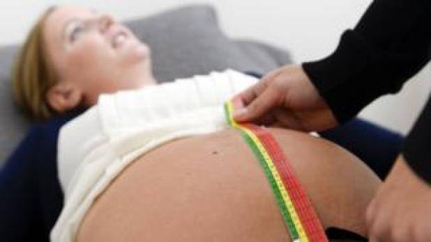 A pregnant woman is checked at a maternity clinic in Stockholm, Sweden