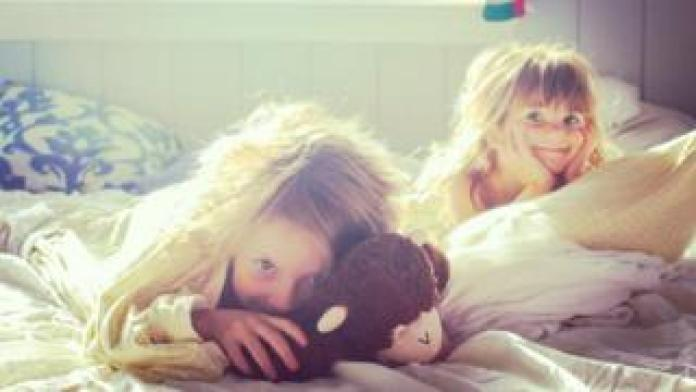 Two girls who wake up
