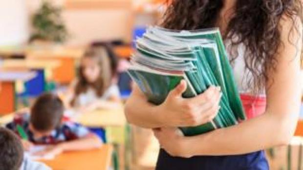 Woman teacher in classroom