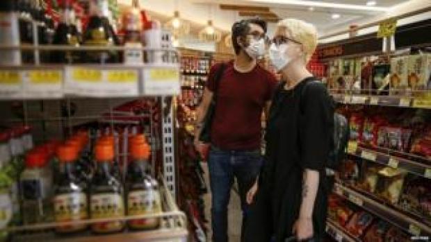 Customers wearing masks in shops in London