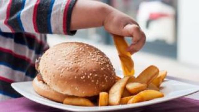 Child eats chips