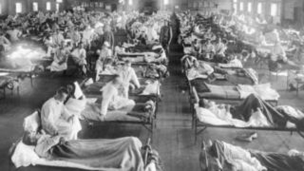 In this 1918 photograph, influenza victims crowd into an emergency hospital at Camp Funston, a subdivision of Fort Riley in Kansas