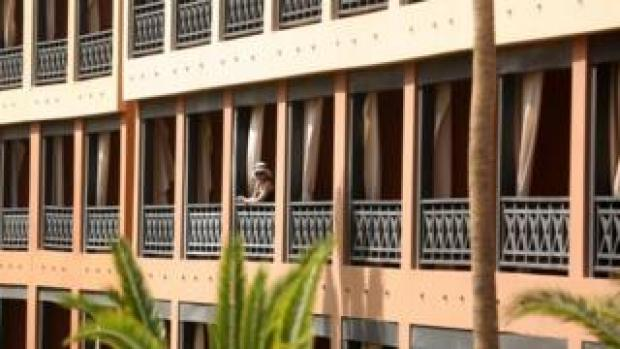 A tourist looks on from her balcony at a quarantined hotel in Tenerife