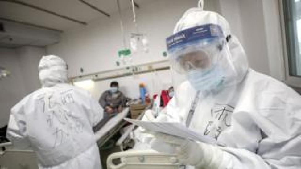 A medical worker in protective suit