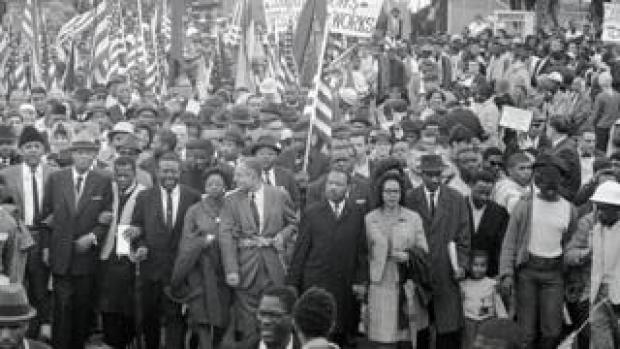 Dr. Martin Luther King (center) leads an estimated 10,00 or more civil rights marchers out on the last leg of their Selma-to Montgomery march - 25 March 1965