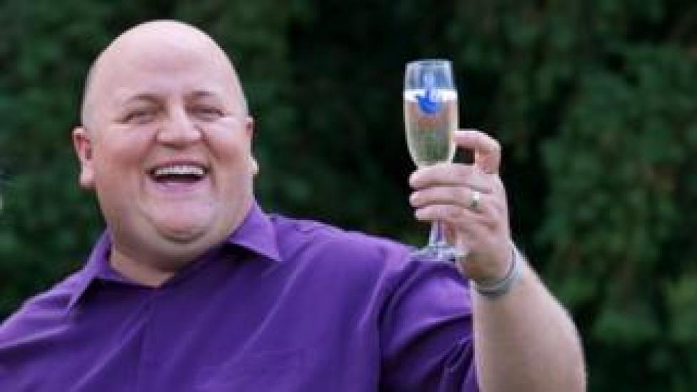 Adrian Bayford celebrates his lottery win