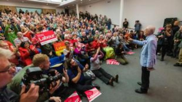 """Britain""""s Opposition Labour Party Leader Jeremy Corbyn (C) delivers a speech at a member mobilisation rally and local campaign launch (climate crisis and Green Industrial Revolution) event at the University of Gloucester in Gloucester,"""