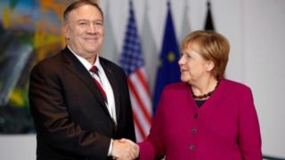 trump German Chancellor Angela Merkel shakes hands with US Secretary of State Mike Pompeo during a news conference in Berlin, Germany November 8, 2019