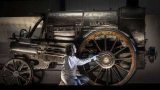 Lead Conservator Wendy Somerville-Woodiwis unveils Stephenson's Rocket at its new home, the National Railway Museum in York in September