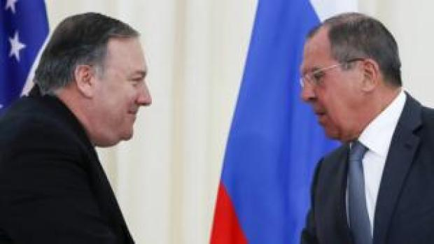 US Secretary of State Mike Pompeo and Russian Foreign Minister Sergei Lavrov shake hands