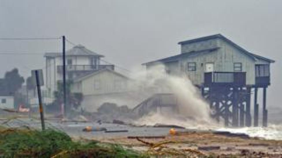 NEWS Waves crash into stilt houses along the shore at Alligator Point in Franklin County, Florida
