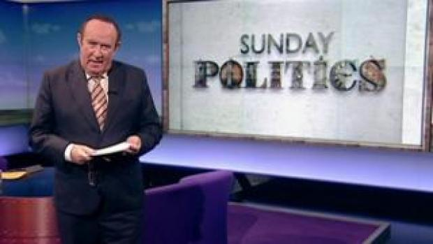 Andrew Neil with Sunday Politics logo