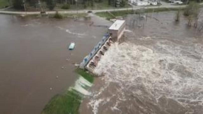 An aerial view of flooding as water overruns Sanford Dam, Michigan