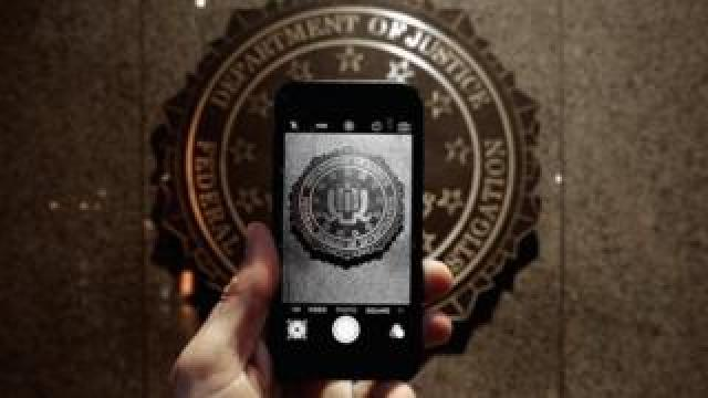 Official seal of the FBI is seen on an iPhone's camera screen on February 23, 2016 in Washington DC